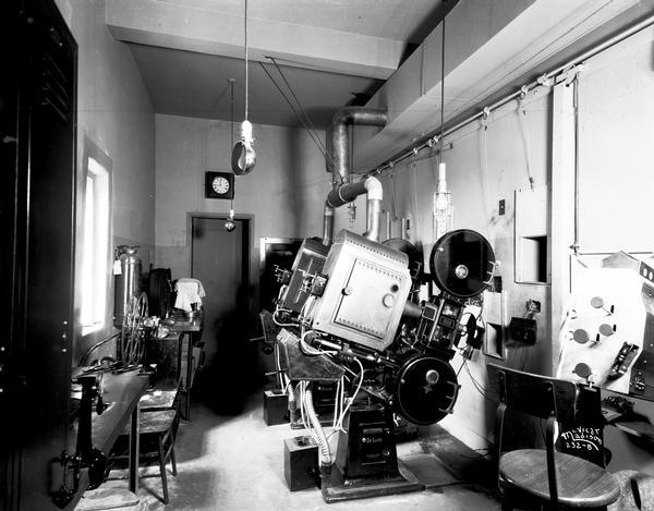 The projection room in the Orpheum Theatre, with projectors and other equipment ready for movie viewing.