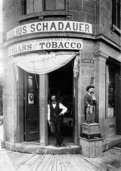 A man posing in the doorway of Julius Schadauer's tobacco shop at 101 State Street.