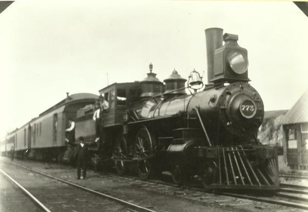 Chicago, Milwaukee, and St. Paul Railway engine #542, class H4, built by Schenectady Locomotive Works in 1882. Renumbered 773 In April of 1899, 226 in October of 1912, and scrapped on September 28, 1918. The train is shown here ready to leave for Milwaukee. Conductor Henry F. Durbin is on the ground by the engine, Engineer William H. Ellis is in the cab window and Fireman Charles E. Milles is in the gangway.
