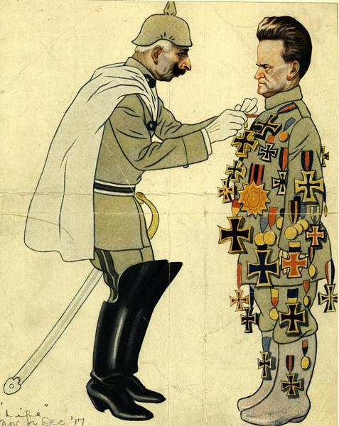 A color cartoon depicting Robert M. La Follette, Sr. as pro-German, showing Kaiser pinning medals on him.