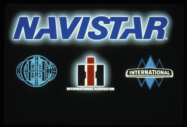 "Poster introducing the ""Navistar"" brand name. Features illustrations of logos and/or trademarks that preceded the change, including the ""triple diamond""."