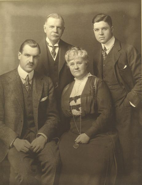Formal studio portrait of Cyrus Hall McCormick, Jr., his wife, and their two sons. McCormick was president of the McCormick Harvesting Machine Company from 1884 to 1902, and president of the International Harvester Company after 1902.
