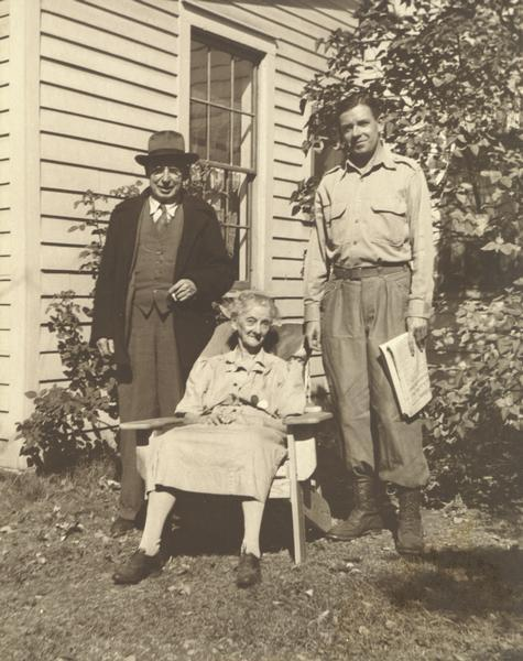 "Portrait of Homer Bigart with elderly couple. Bigart was an award-winning journalist with the ""New York Herald-Tribune"" and the ""New York Times""."