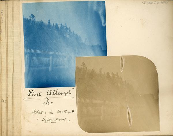 "Scrapbook page containing a cyanotype and albumen print of a picket fence and the caption: ""First Attempt;"" 1887, What's the Matter? ""Light struck."""