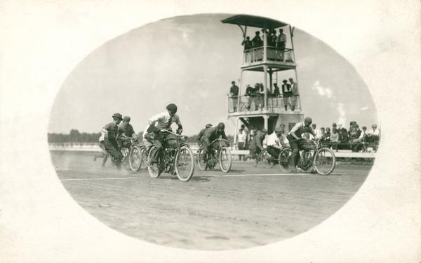 Motorcyclists at the start of the race, probably at the Wisconsin State Fairgrounds.