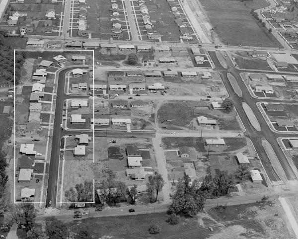 Aerial view of Midvale neighborhood under construction near Madison's southwestern city limits. The view is focused on the area bounded by Tokay Boulevard, Midvale Boulevard, and Odana Road, with a block of homes along Odell Street featured in the 1955 Parade of Homes marked with a white boundary.
