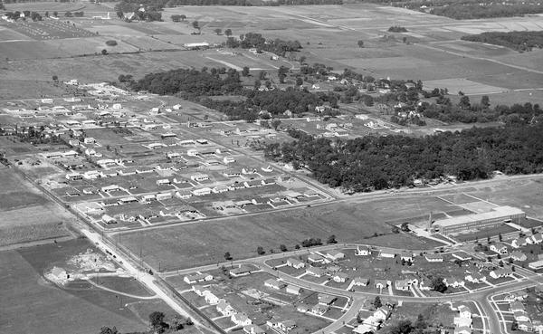 Aerial view of the Midvale neighborhood under construction showing the intersection of Midvale and Tokay Boulevards near the southwestern city limits of Madison.
