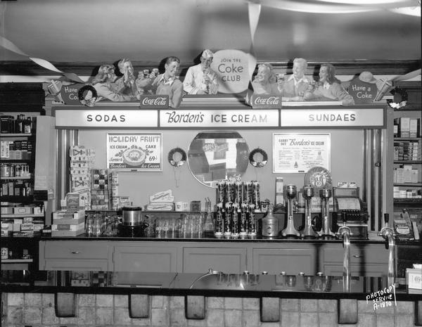 First soda fountain images galleries for Old fashioned pharmacy soda fountain