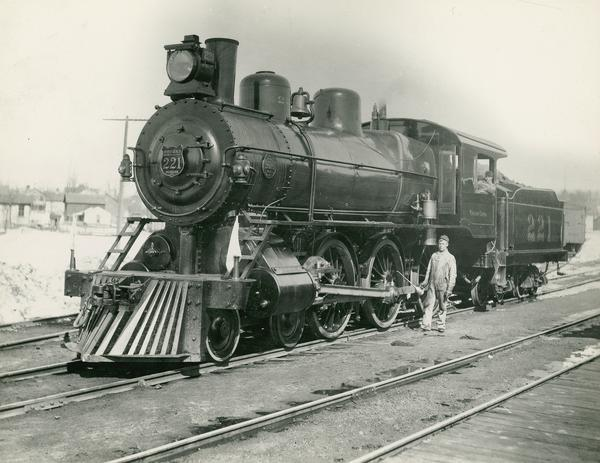 "Wisconsin Central Railway locomotive no. 221, the first ""big engine"" on the Wisconsin Central.  Built by the Brooks Locomotive Works in 1898, and later renumbered 2619 on the Minneapolis, St. Paul and Sault Ste. Marie, where she was a class E-22.  Engineer Arthur Willett and fireman Al Follett are also pictured."