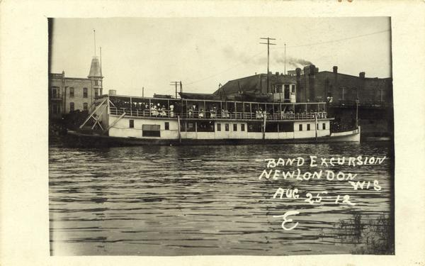 "A band excursion on the sternwheel excursion, ""Thistle."" The sternwheel was previously named ""J.H. Crawford."""