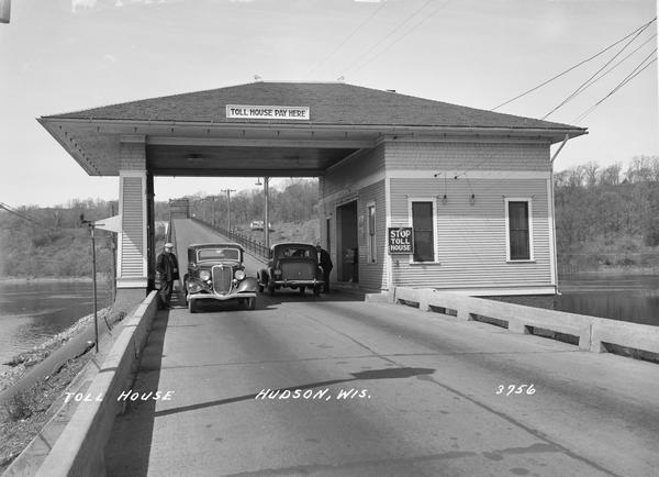 Toll house in Hudson showing two cars passing through.