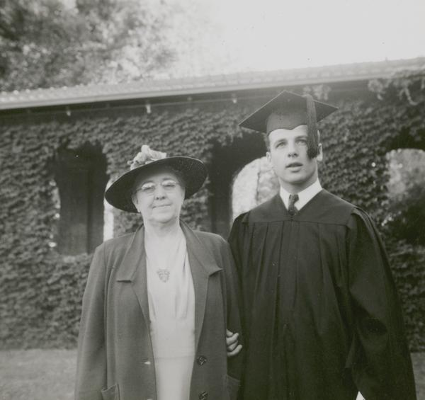 Gaylord Nelson, dressed in cap and gown, poses with his mother Mary Nelson at his graduation from San Jose State College in 1939.