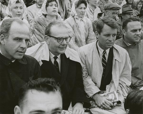 Governor Gaylord Nelson attending a Green Bay Packers-Detroit Lions football game. From left to right, senatorial candidate Gaylord Nelson, gubernatorial candidate John W. Reynolds, Robert Kennedy, and 8th District Congressional candidate Owen Monfils. This photograph was taken during the campaign.