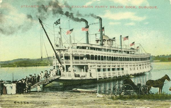 The sternwheel excursion <i>J.S.</i>, loading an excursion party below dock. Horse and cart in foreground.