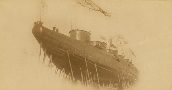 "Captian Alex McDougall's passenger whaleback steamer the ""Christopher Columbus"" being built in the shipyard of the American Steel Barge Company."