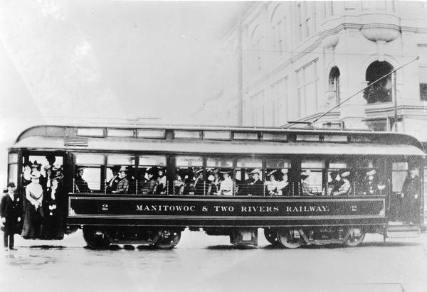 Manitowoc and Two Rivers Railway streetcar full of passengers.
