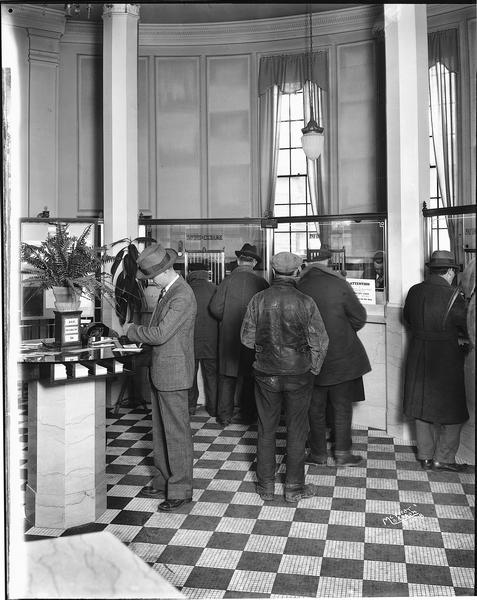 Lobby of the Security State Bank, with depositors waiting in line at teller's windows.