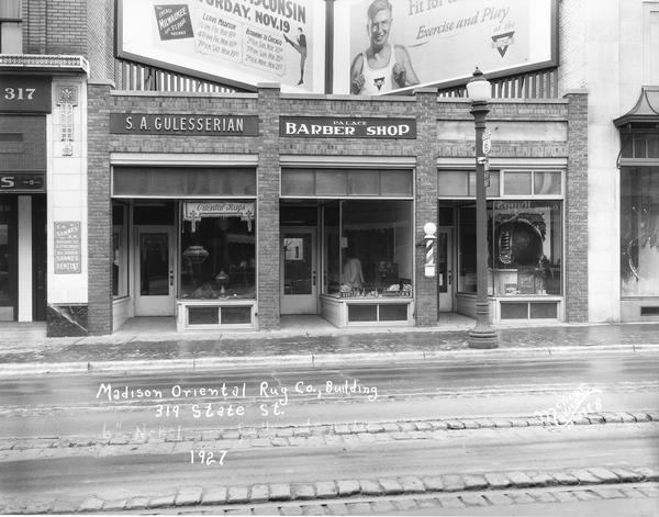 Oriental rug business owned by Solomon Gulessarian at 319 State Street. The Palace Barber Shop is next door on the right.