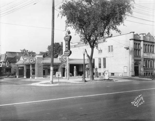 "A Texaco service station located on the corner of University Avenue and Lake Street. The station replaced a home laundry service pictured in a 1927 McVicar photograph of the same corner. Also included is the Wheeler Conservatory of Music, 626 University Avenue. Text with print reads: ""Texaco Station, Capital Super Service, 630-32 University Avenue, Wheeler Conservatory of Music, 626 University Avenue."""