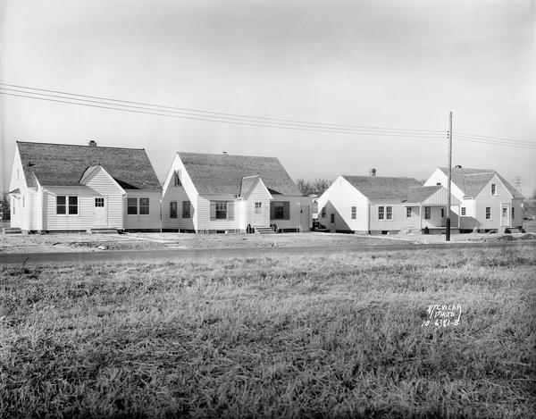 A row of houses at 826, 830, 834 & 838 North Fair Oaks Avenue built by the Fitzpatrick Lumber Company in what was the Town of Blooming Grove, now near East Washington Avenue.