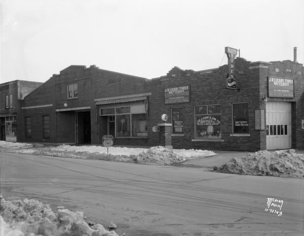 Exterior of the J.R. Licari & Son garage, located at 767 West Washington Avenue. The view also includes Trotters Billiards, located at 763 West Washington Avenue. Greenbush neighborhood.