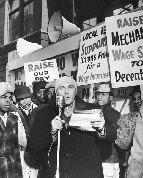"Herbert March speaking at the ""Negro and White, Unite and Fight"" rally in -8 F degree weather."