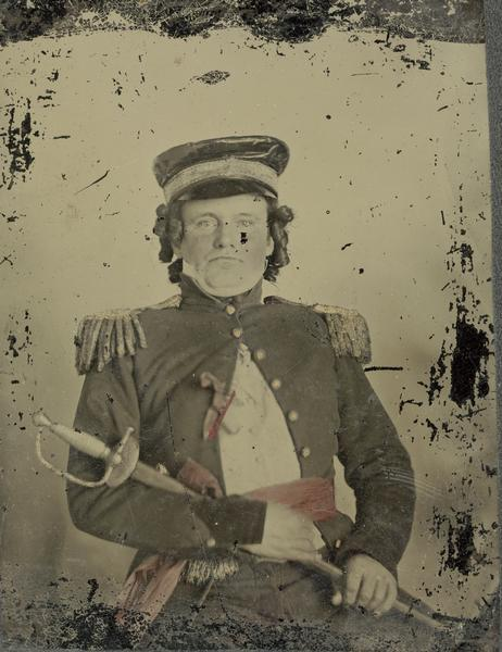 "An actor dressed as an army officer, holding a saber, for the performance of ""Black Hawk, or Lily of the Prairie,"" a drama written by Mary Elizabeth Mears of Fond du Lac, Wisconsin, and presented in Madison, Wisconsin in 1857."