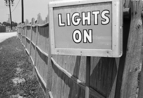 """Lights On"" sign at the Starlite, a drive-in movie theatre."