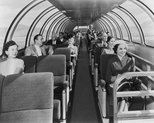Passengers seated on the upper level of a Milwaukee Railroad superdome coach.