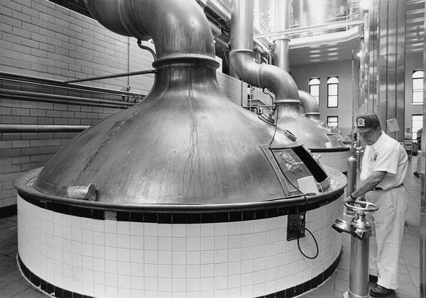 Richard A. Schulz checks a kettle of beer brewing at the Pabst Brewery.