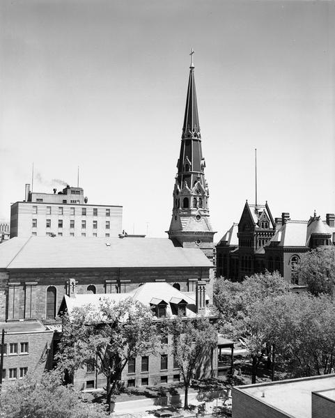Elevated view of Saint Raphael's Cathedral, 216 West Main Street, with the Dane County Courthouse, 207 West Main Street, in the right background and the Park Hotel annex in the left background.  The parish rectory, 222 West Main Street, is in the foreground.