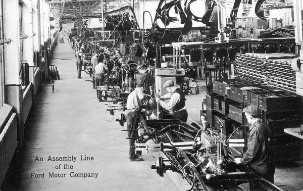 Men working on the automobile assembly line in the Rouge Plant of the Ford Motor Company.