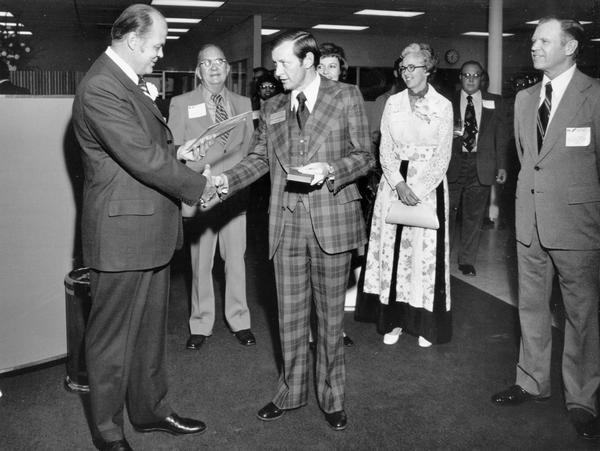 "Original caption reads: ""K.P. Mazurek (left), President, International Harvester's Truck Division, receives the key to the city of El Paso, Texas, from Mayor Pro Tem Don Henderson, during the grand opening of International trucks' new sales and service branch operation, 1341 Lomaland Drive, El Paso, Texas. Looking on are Mrs. Mazurek and D.K. Headley, manager or the IH truck Dallas sales region."""