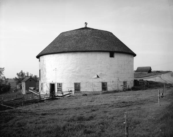 "Round barn on ""Ridge Road"" in Ontario vicinity."