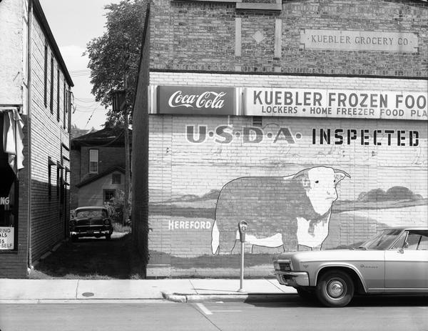Kuebler Grocery Company, a meat market with a steer painted on its outside brick wall, on Main Street.