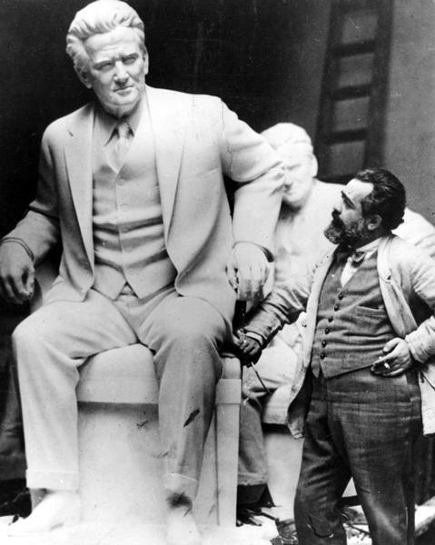 Sculptor Jo Davidson standing next to his larger than life statue of Senator Robert M. La Follette, Sr.  The statue was presented to the National Statuary Hall Collection in the U.S. Capitol in 1929.  Davidson also carved a bust of La Follette from life, a copy of which sits in the rotunda of the Wisconsin State Capitol.