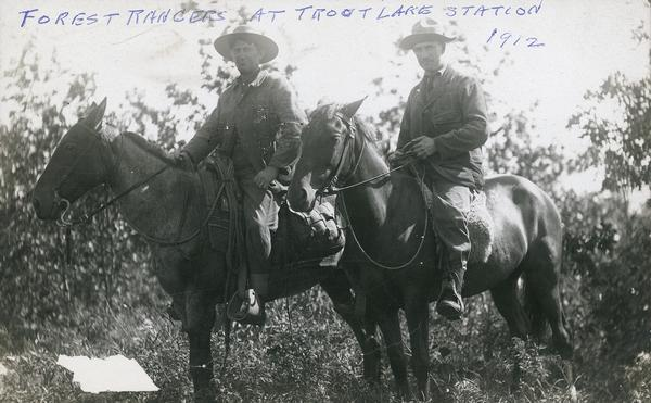 Two forest rangers on horseback at Trout Lake Station.