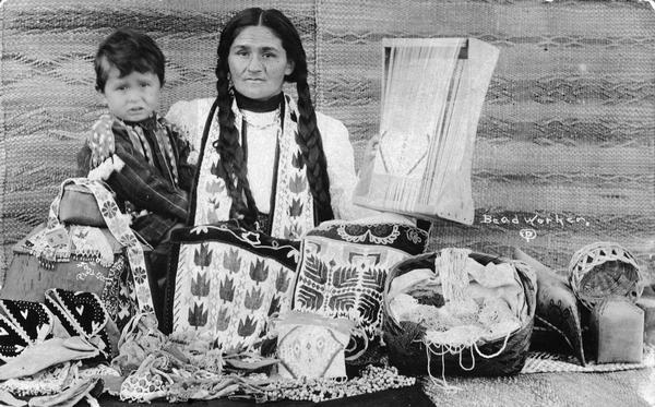 Chippewa (Ojibwa) woman with child.