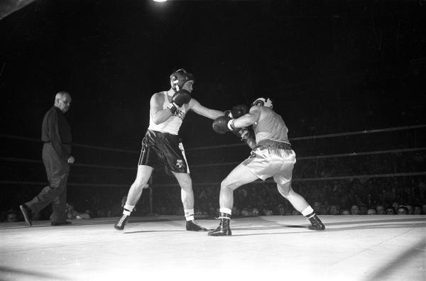 Unidentified (Charlie Mohr?) University of Wisconsin boxer, during a boxing match.