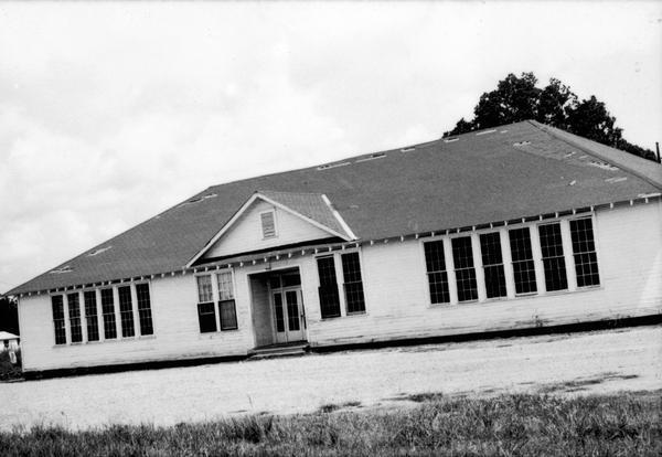Front view of a high school for African American students. SNCC Arkansas Project.