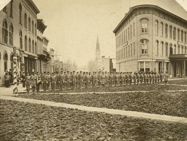The Guppey Guard, a Wisconsin state militia unit, in formation on a street in Portage.