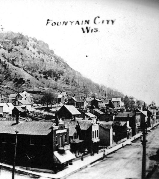 Elevated view of Fountain City, with bluffs in the background.