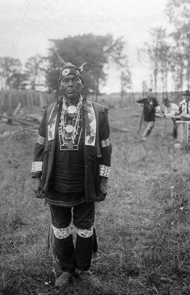 Simon Onanguisse Kahquados (1851-1930) of Forest County, Wisconsin, the last hereditary chief of the Potowatomi. This image is part of an exhibit about Native Americans prepared by Paul Vanderbilt, the Wisconsin Historical Society's first curator of photography.
