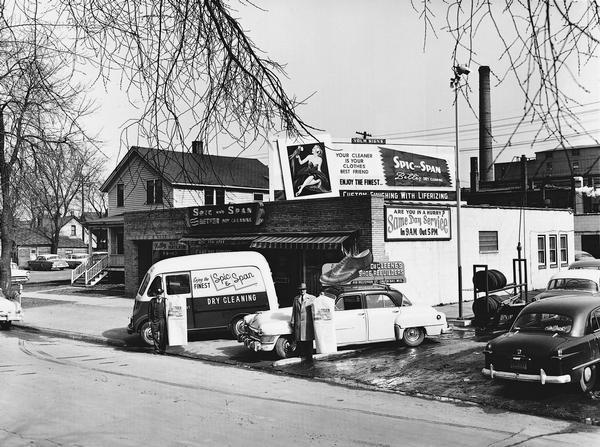 Store front and delivery vehicles of Spic and Span Dry Cleaning. Green Bay, Wisconsin. March 14, 1957.