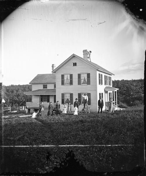 Harold and Gunhild Mickelson with five of their daughters (Bertha Mickelson Bragger and her husband stand on the right), in Section 23 of the Town of Blue Mounds.