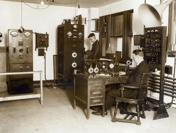 Interior of WMAQ Radio Station with Chief Engineer Donald Weller standing.