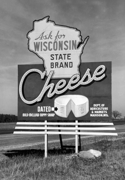 Highway billboard advertising Wisconsin cheese for the Department of Agriculture and Markets.