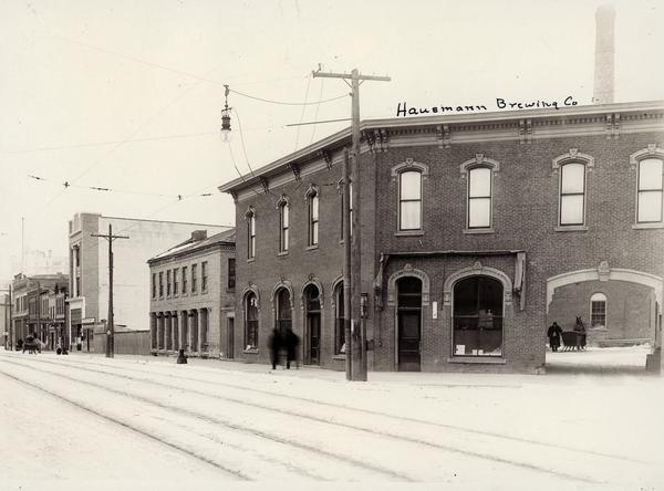 Exterior view of the Hausmann Brewing Company on the corner of State and Gorham Streets. It was razed in 1923-4.