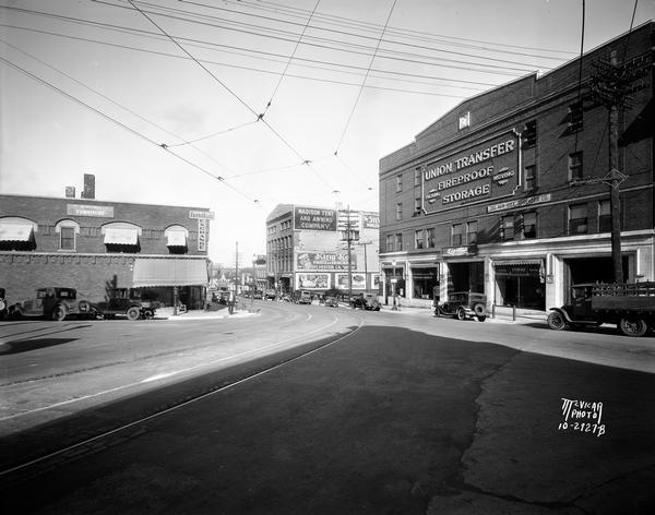 View down East Wilson Street from the corner of King Street. The Union Transfer Building is on the right hand side at 155-303 East Wilson Street, Rubin's Furniture is at 302-4 East Wilson Street, and Madison Tent and Awning is at 313 East Wilson Street.