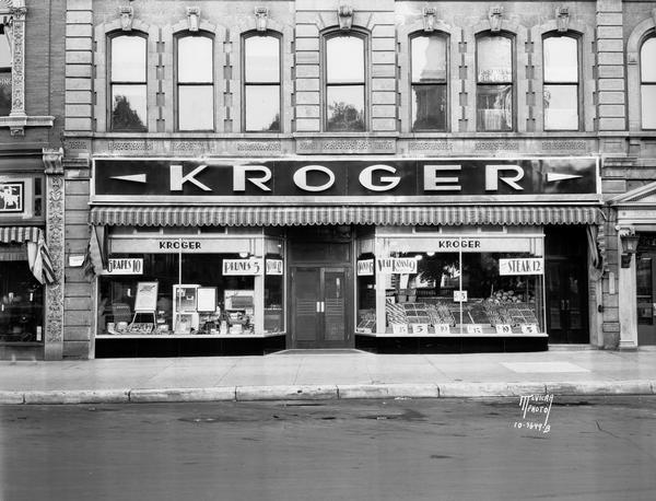 Kroger Complete Food Market, 3-5 North Pinckney Street, with black vitrolite front, chromium trim, and a modernistic Art Deco sign in chromium-plate letters.